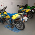 The husaberg 650 parked in the garage