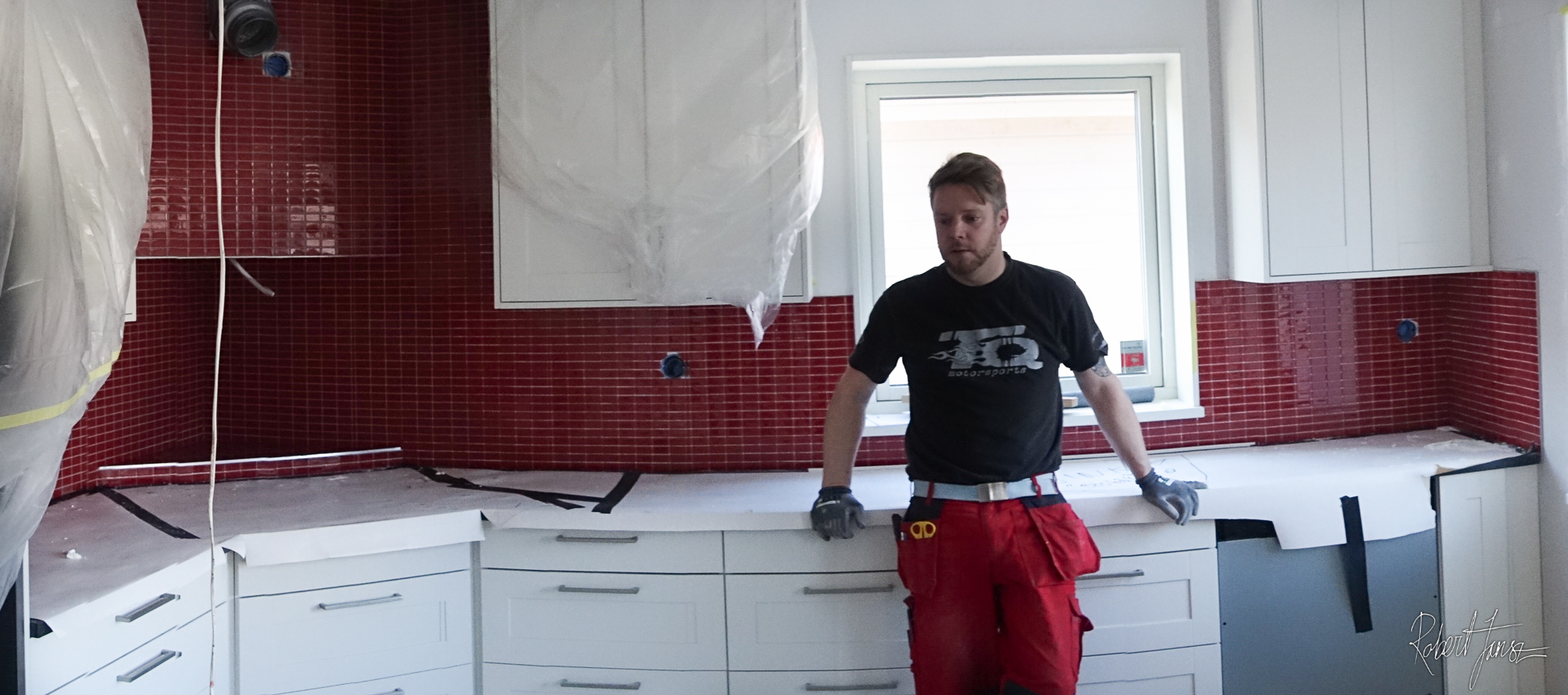 Finished kitchen with red mosaic tiles