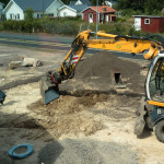 Excavator digging the hole for the trampoline